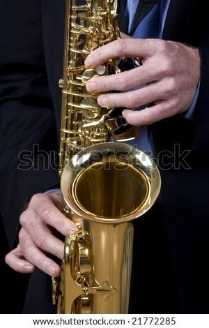 jazz musician playing saxophone - stock photo