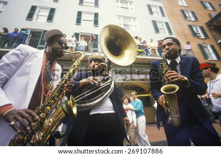 Jazz musicians performing on the French Quarter, New Orleans at Mardis Gras, LA - stock photo
