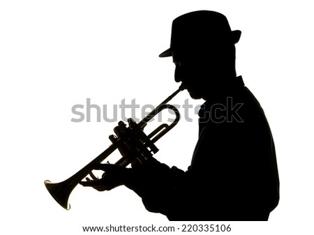 jazzman playing trumpet, silhouette