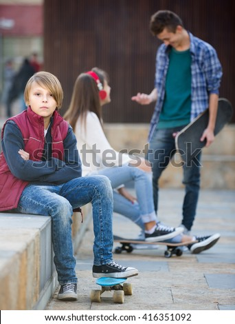 Jealous russian teen and his friends after conflict outdoors  - stock photo