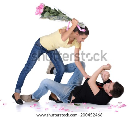 Jealous young woman beat her boyfriend bouquet of flowers for lipstick on your face - stock photo