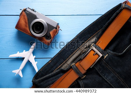 Jeans and accessories on blue Wooden Background - stock photo
