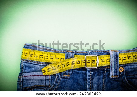 Jeans and measuring subject for weight loss - stock photo
