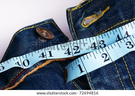 jeans and measuring - unhealthy big size - stock photo