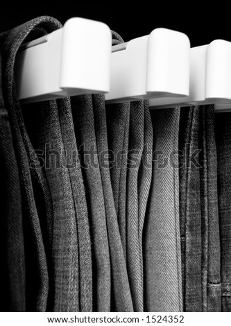 Jeans hanging in closet - stock photo