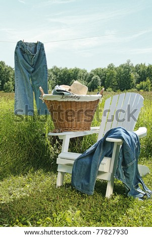 Jeans hanging on clothesline with blue sky - stock photo