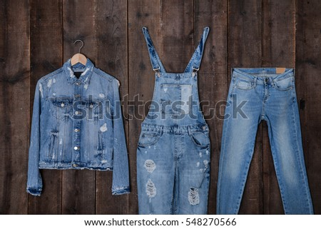 jeans jacket with blue jeans on a wooden background