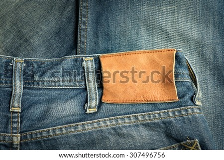 jeans pants with brown leather tag empty for your text - stock photo