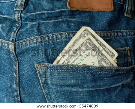 jeans pocket and money - stock photo