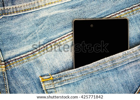 Jeans pocket with mobile smart phone