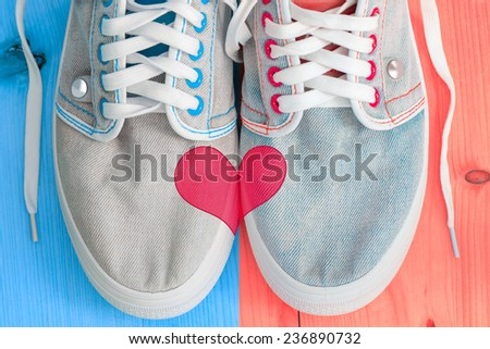 Jeans shoes with heart shape - stock photo