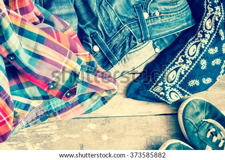 jeans,sneakers and bandanna on floor/toned photo - stock photo