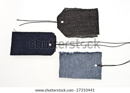 Jeans tags with laces isolated on white - stock photo