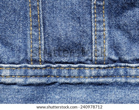 Jeans texture with seam - stock photo