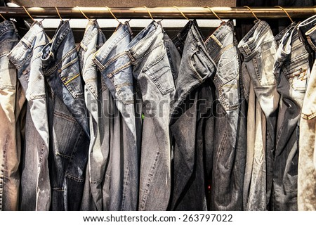 jeans trousers in a row - stock photo