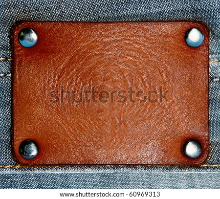 Jeans with blank brown label - stock photo
