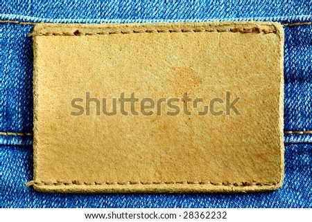 Jeans with blank leather label for your own text - stock photo
