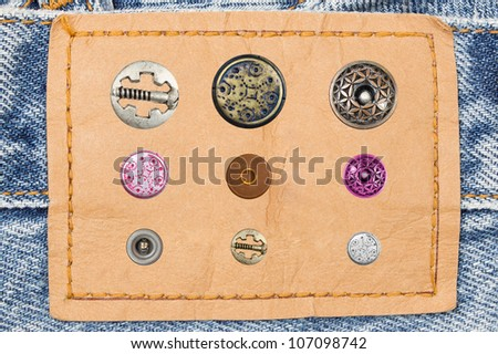 Jeans with label and set of various jeans' metal rivets and buttons