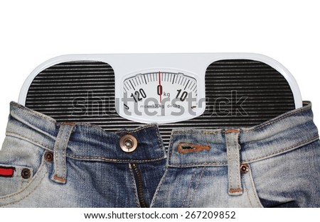 Jeans wrapped around bathroom scales - stock photo