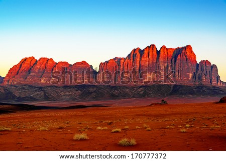 Jebel Qatar in Wadi Rum, Jordan at early-morning. Wadi Rum is known as The Valley of the Moon and a UNESCO World Heritage Site. - stock photo
