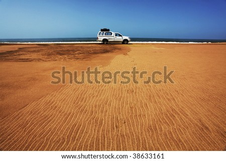 Jeep in desert - stock photo