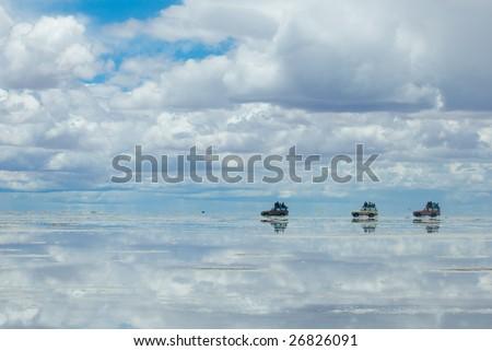 jeeps in the salt lake salar de uyuni, bolivia - stock photo