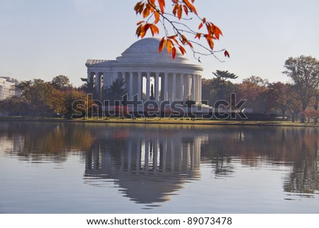 Jefferson Memorial in the autumn, reflected in the water - stock photo