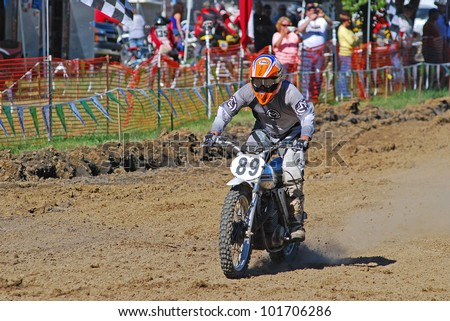 JEFFERSON TX - APR 21: Former National Champion Guy Cooper won both motos of Over 40 Expert at Diamond Don's AHRMA Riverport National Vintage Motocross Nationals on April 21, 2012 in Jefferson TX. - stock photo
