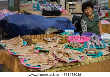 JEJU, SOUTH KOREA - SEPTEMBER 29, 2015: Woman selling fishes in Dongmun Market.