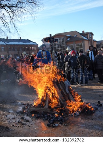 JEKABPILS, LATVIA - MARCH 16: citizens watch at the burning effigy at Celebration of Maslenitsa - traditional Russian holiday - on March 16, 2013 in Laukums pie Justicijas nama, Jekabpils, Latvia