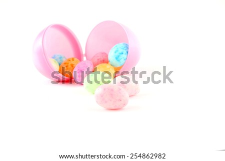 Jelly beans and easter egg over white background. - stock photo