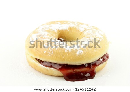 Jelly donut with strawberry jam, on a white background