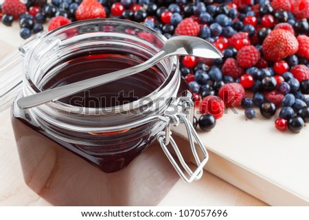 jelly from summer berries: redcurrant, blueberries, raspberries, black currant, strawberries - stock photo
