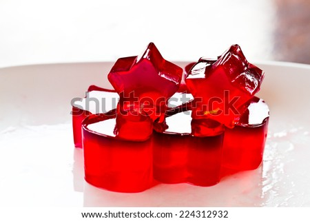 jelly shape star gelatin sweet dessert in the dish on the table - stock photo