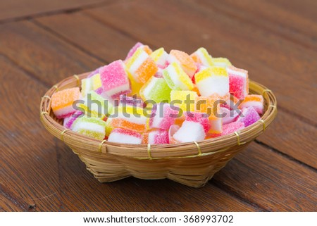 Jelly sweet, flavor fruit, candy dessert colorful, on wooden background - stock photo