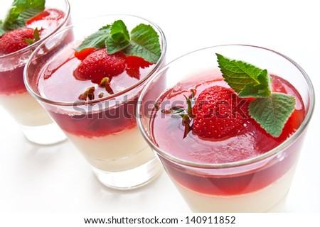 Jelly with strawberry in the glass topped mint leaf - stock photo