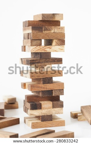Jenga, Wood blocks stack game on white background. - stock photo
