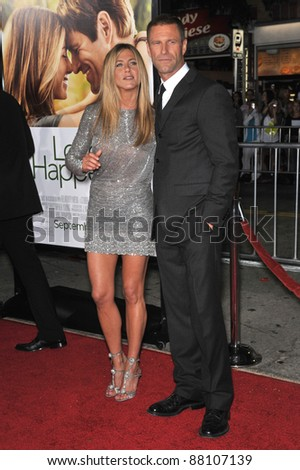 "Jennifer Aniston & Aaron Eckhart at the world premiere of their new movie ""Love Happens"" at the mann Village Theatre, Westwood. September 15, 2009  Los Angeles, CA Picture: Paul Smith / Featureflash"