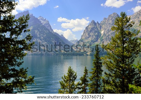 Jenny Lake and mountains of the Grand Teton National Park, Wyoming in Summer - stock photo