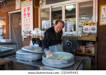 JEONJU, SOUTH KOREA - 03 NOVEMBER 2014: A chef prepares to steam red bean paste buns in a restaurant in the Jeonju Hanok village. The steamed buns is a traditional delicacy in South Korea. - stock photo