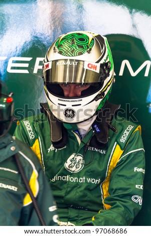 JEREZ DE LA FRONTERA, SPAIN - FEB 07: Heikki Kovalainen of Catherham F1 waiting in pit on training session on February 07 , 2012, in Jerez de la Frontera , Spain - stock photo