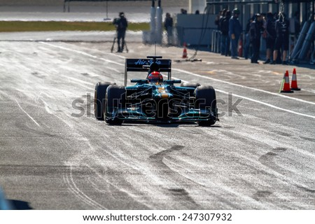 JEREZ DE LA FRONTERA, SPAIN - FEB 10: Jarno Trulli of Catherham F1 entering to the pit on training session on February 10 , 2012, in Jerez de la Frontera , Spain - stock photo