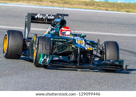 JEREZ DE LA FRONTERA, SPAIN - FEB 10: Jarno Trulli of Catherham F1 races on training session on February 10 , 2012, in Jerez de la Frontera , Spain - stock photo