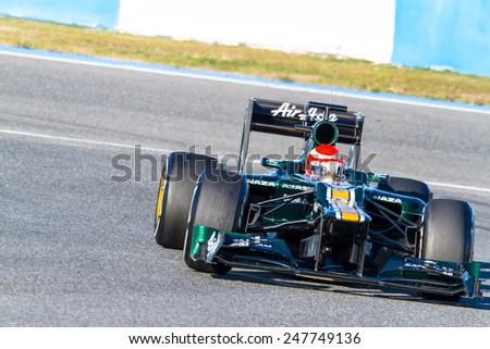 JEREZ DE LA FRONTERA, SPAIN - FEB 10: Jarno Trulli of Catherham F1 races on training session on February 10 , 2012, in Jerez de la Frontera , Spain - stock photo