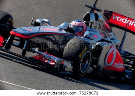 JEREZ DE LA FRONTERA, SPAIN - FEB 11: Jenson Button of McLaren F1 races in training session on February 11, 2011, in Jerez de la Frontera, Spain - stock photo