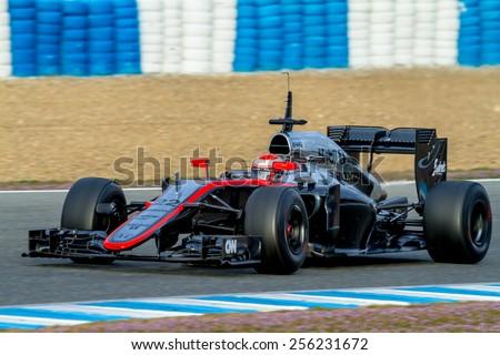 JEREZ DE LA FRONTERA, SPAIN - FEB 02:  Jenson Button of McLaren Honda F1 races on training session on February 02 , 2015, in Jerez de la Frontera , Spain - stock photo