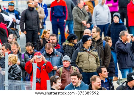 JEREZ DE LA FRONTERA, SPAIN - FEB 03: Lots of people seeing the Formula One training session on the racetrack of Jerez de la Frontera on February 03 , 2015, in Jerez de la Frontera , Spain - stock photo