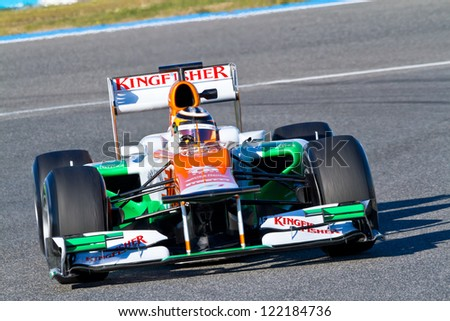 JEREZ DE LA FRONTERA, SPAIN - FEB 10: Nico Hulkenberg of Force India F1 races on training session on February 10 , 2012, in Jerez de la Frontera , Spain - stock photo
