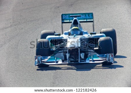 JEREZ DE LA FRONTERA, SPAIN - FEB 10: Nico Rosberg of Mercedes F1 races on training session on February 10 , 2011, in Jerez de la Frontera , Spain - stock photo