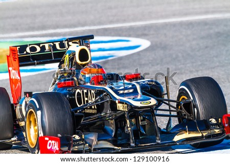 JEREZ DE LA FRONTERA, SPAIN - FEB 10: Romain Grosjean of Lotus Renault F1 races on training session on February 10 , 2012, in Jerez de la Frontera , Spain - stock photo